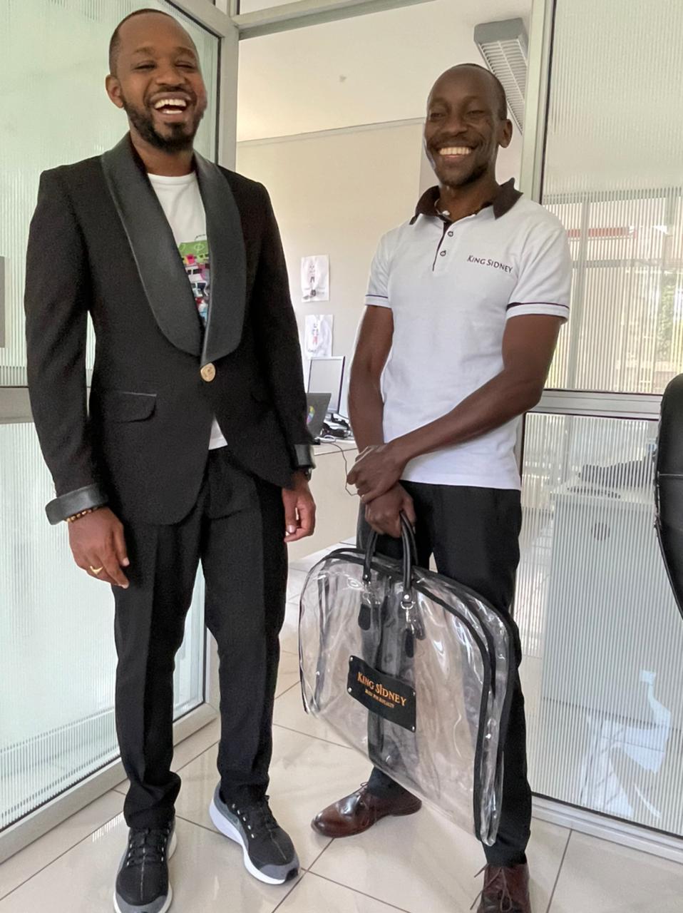 Boniface Mwangi tries on Luxembourg King Sidney tuxedo